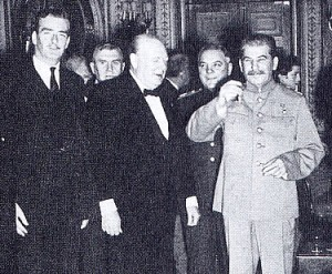 Reader Bullard in Tehran, 1943, flanked by Anthony Eden and Winston Churchill. Josef Stalin gives a wave